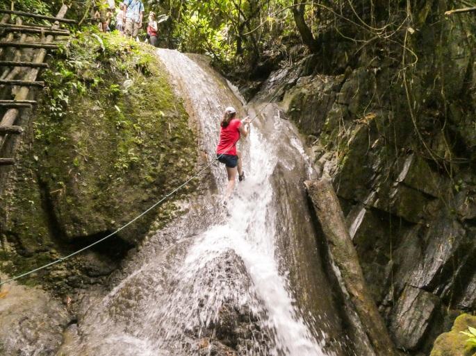 climbing up waterfall
